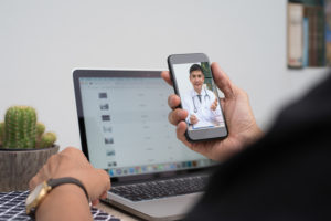telehealth; patient seeing doctor on phone